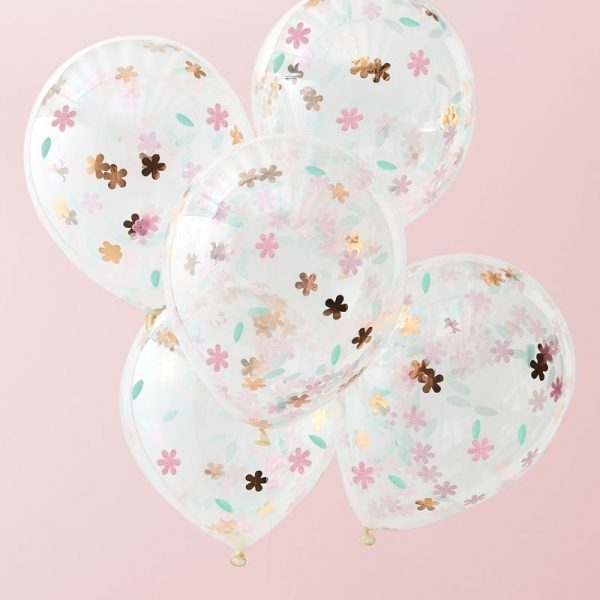 5 globos rellenos con una mezcla de confeti de colores rosa dorado y rosa para crear el escenario perfecto para una fiesta de té.